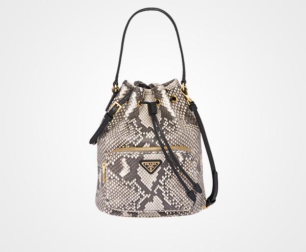 566cdcb3b8ac ... promo code python and saffiano leather bucket bag prada light greyblack  4c1b5 9d16e